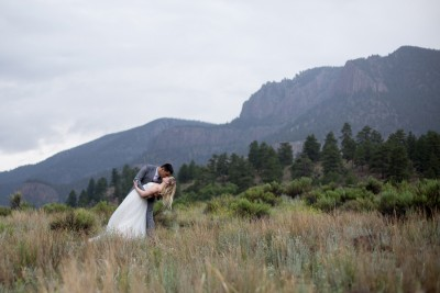 63 dramatic mountain background bride groom kiss