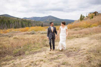P Bride and Groom walk in the Mountains
